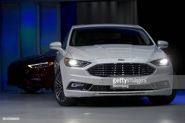 A Ford Motor Co Fusion Hybrid vehicle is driven out during a presentation at the 2016 North American International Auto Show in Detroit Michigan US...