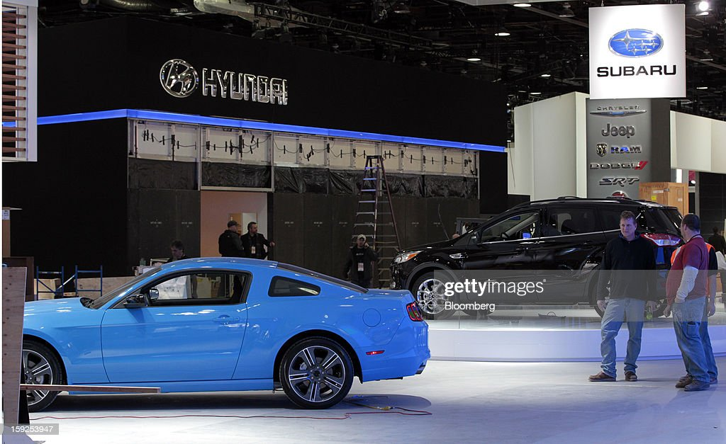 A Ford Motor Co. Mustang, left, sits on the floor near the Hyundai Motor Co. and Subaru exhibits during an advance tour of the North American International Auto Show (NAIAS) at Cobo Hall in Detroit, Michigan, U.S., on Thursday, Jan. 10, 2013. More than 23,000 attendees representing almost 2,000 companies are expected to attend the industry preview for NAIAS on Jan. 16-17. The general public can attend the show from Jan. 19-27. Photographer: Jeff Kowalsky/Bloomberg via Getty Images