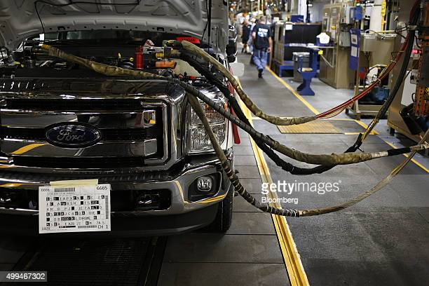 A Ford Motor Co Super Duty series pickup truck is filled with automotive fluids on the assembly line at the company's truck manufacturing plant in...