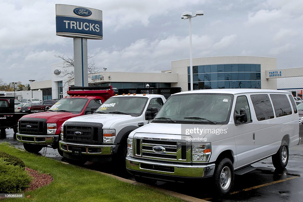 Ford Motor Co. vans and pick-up trucks sit on the dealership lot at & Ford Posts Record $1.69 Billion Third-Quarter Profit Photos and ... markmcfarlin.com