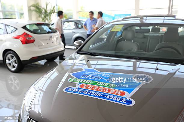 Ford Motor Co vehicles are displayed at a dealership in Beijing China on Tuesday Aug 28 2012 Ford lagging behind General Motors Co and Volkswagen AG...