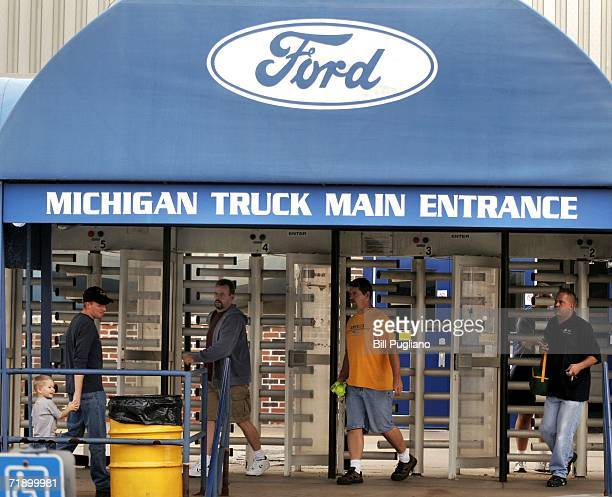 Ford Motor Company employees exit a gate after their shift at the Michigan Truck Plant September 15 2006 in Wayne Michigan Ford announced it will cut...
