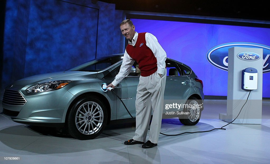 Ford Motor Company President and CEO <a gi-track='captionPersonalityLinkClicked' href=/galleries/search?phrase=Alan+Mulally+-+Businessman&family=editorial&specificpeople=226958 ng-click='$event.stopPropagation()'>Alan Mulally</a> plugs in the brand new all-electric Ford Focus after he delivered a keynote address at the 2011 International Consumer Electronics Show at the Las Vegas Hilton January 7, 2011 in Las Vegas, Nevada. CES, the world's largest annual consumer technology tradeshow, runs from January 6-9 and is expected to feature 2,700 exhibitors showing off their latest products and services to about 126,000 attendees.