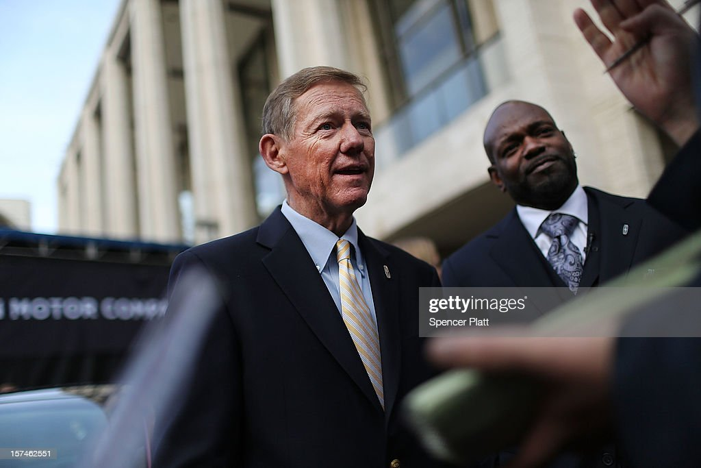 Ford Motor Company President and CEO <a gi-track='captionPersonalityLinkClicked' href=/galleries/search?phrase=Alan+Mulally+-+Businessman&family=editorial&specificpeople=226958 ng-click='$event.stopPropagation()'>Alan Mulally</a> (L) stands with <a gi-track='captionPersonalityLinkClicked' href=/galleries/search?phrase=Emmitt+Smith&family=editorial&specificpeople=201615 ng-click='$event.stopPropagation()'>Emmitt Smith</a> as he speaks to the press during a media launch for the new Lincoln Motor Company MKZ sedan in front of Avery Fisher Hall, Lincoln Center Plaza on December 3, 2012 in New York City. Ford is renaming its Lincoln division as the Lincoln Motor Co., as it looks to revive the luxury brand. The MKZ will arrive at dealerships later this month and will start at $35,925. The MKZ is the first of seven new Lincoln's that will go on sale by 2015.