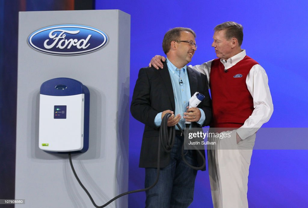 Ford Motor Company President and CEO <a gi-track='captionPersonalityLinkClicked' href=/galleries/search?phrase=Alan+Mulally+-+Businessman&family=editorial&specificpeople=226958 ng-click='$event.stopPropagation()'>Alan Mulally</a> (R) talks with Ford Manager of Global Electrification Infrastructure Mike Tinskey after demonstrating a new charging station during a keynote address at the 2011 International Consumer Electronics Show at the Las Vegas Hilton January 7, 2011 in Las Vegas, Nevada. CES, the world's largest annual consumer technology tradeshow, runs from January 6-9 and is expected to feature 2,700 exhibitors showing off their latest products and services to about 126,000 attendees.
