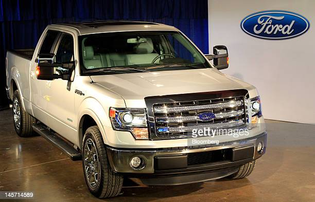 Ford Motor Co's 2013 F150 pickup truck sits on display at an event in Bruceville Texas US on Monday June 4 2012 The 2013 F150 introduces new frontend...