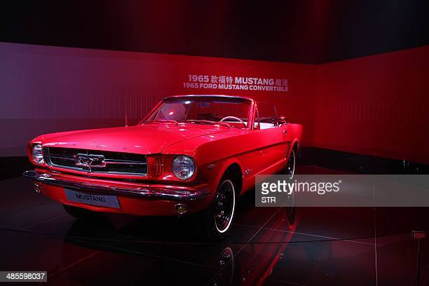 Ford Mustang Convertible car on display at the 50 years celebration ceremony of the Ford Mustang in Beijing on April 19 ahead of the 'Auto China...