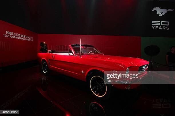 Ford Mustang Convertible car on display at the 50 years celebration ceremony of Ford Mustang in Beijing on April 19 ahead of the 'Auto China 2014'...