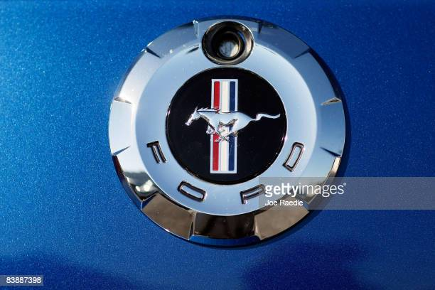Ford Mustang emblem hangs on a car on the sales lot at the Metro Ford dealership December 2 2008 in Miami Florida Ford announced that its November...