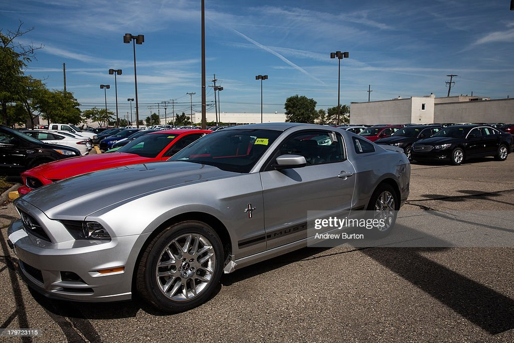 Ford Mustangs sit for sale at Bill Brown Ford Dealership on September 6, 2013 in Livonia, Michigan. U.S. auto giants had a good summer: In August Ford had its best month of retail sales since 2006; General Motors had its best month since 2008.