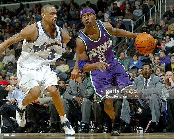J Ford of the Milwaukee Bucks drives around Juan Dixon of the Washington Wizards as the Bucks defeat the Wizards 11385 during NBA action on February...