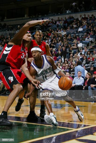 J Ford of the Milwaukee Bucks drives to the basket against Charlie Villanueva of the Toronto Raptors January 27 2006 at the Bradley Center in...