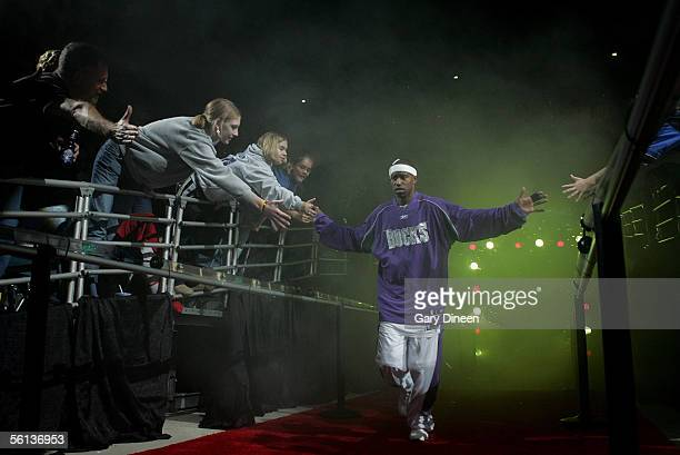 J Ford of the Milwaukee Bucks greets fans as he comes out of the tunnel during player introductions against the Miami Heat during a NBA game November...