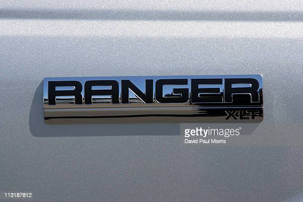 Ford Ranger pickup logo on the side of a vehicle parked on the lot at the Serramonte Ford dealership on April 26 2011 in Colma California Benefiting...
