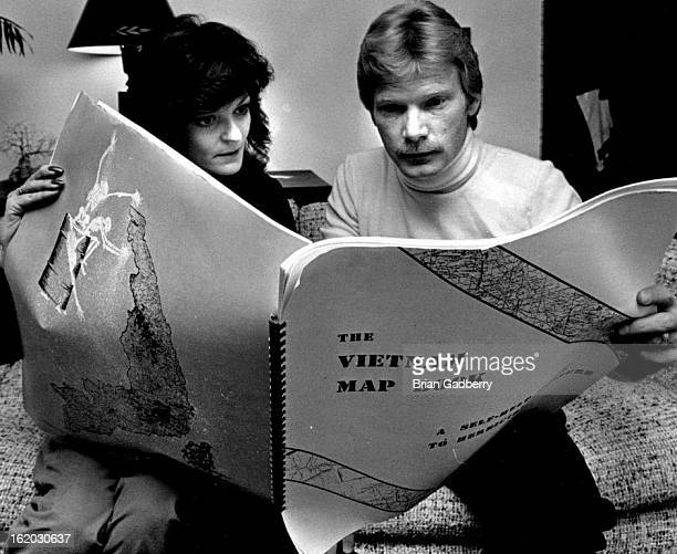 NOV 12 1983 NOV 13 1983 Ford Rod Veteran Rod and Coleen Ford look over a book of maps and figures asian showing the areas Agent Orange was doumped in...