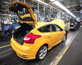 Ford ST gasolinepowered vehicle goes through assembly at the Michigan Assembly Plant November 8 2012 in Wayne Michigan The plant is the only one in...