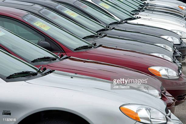 Ford Taurus automobiles sit on the sales lot at World Ford July 9 2002 in Pembroke Pines Florida 'The American really loves nothing but his...