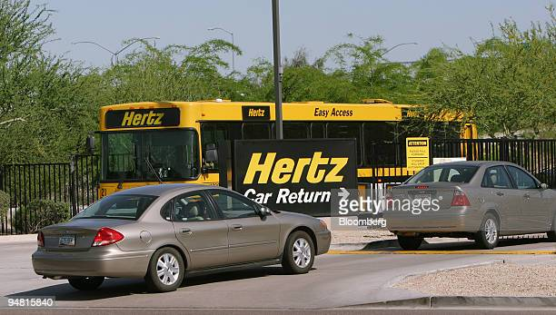 Ford Taurus left and a Ford Focus drive into the car return area of a Hertz rental facility at Sky Harbor Airport in Phoenix Arizona Wednesday April...