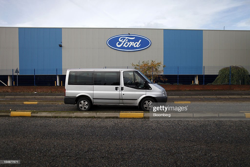 A Ford Transit van passes the Ford Motor Co. automobile plant in Dagenham, U.K., on Monday, Oct. 29, 2012. Ford Motor Co. will shut three European plants, its first factory closings in the region in a decade, and cut 5,700 jobs to stem losses that the carmaker predicts will total more than $3 billion over two years. Photographer: Simon Dawson/Bloomberg via Getty Images