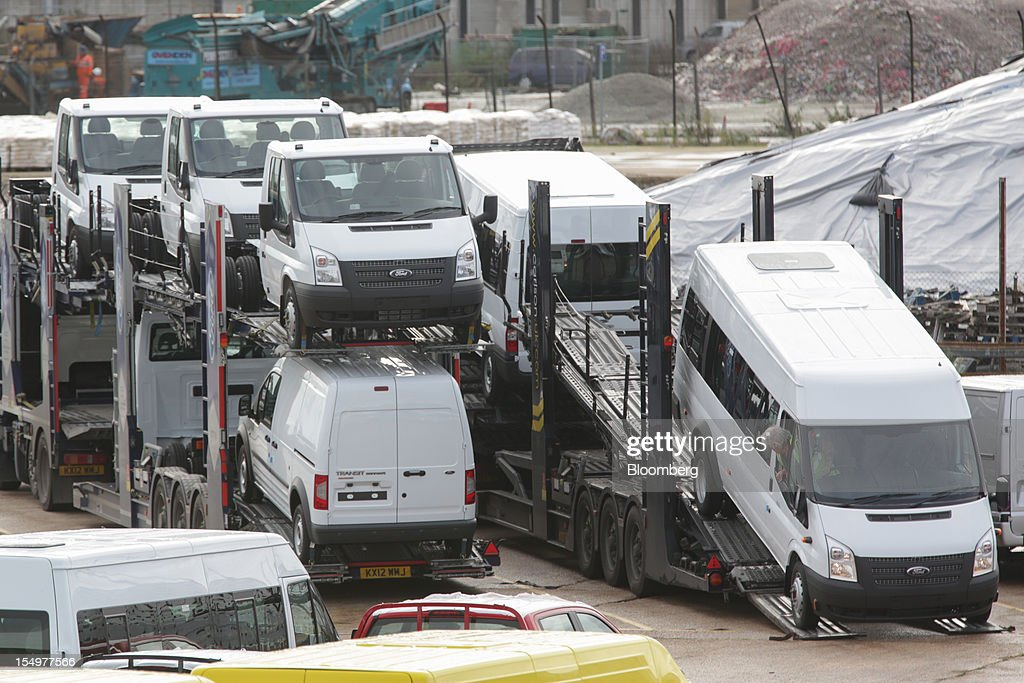 A Ford Transit van, produced by the Ford Motor Co., is loaded onto a transporter in a holding area at the Port of Southampton in Southampton, U.K., on Monday, Oct. 29, 2012. Ford Motor Co. will shut three European plants, its first factory closings in the region in a decade, and cut 5,700 jobs to stem losses that the carmaker predicts will total more than $3 billion over two years. Photographer: Jason Alden/Bloomberg via Getty Images