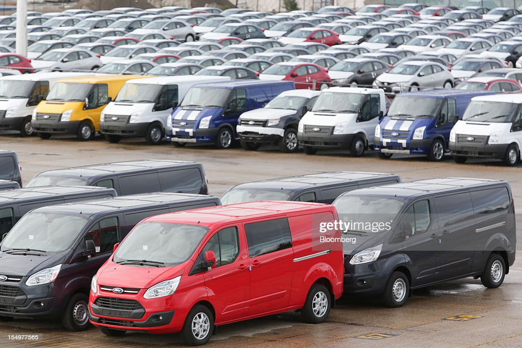 Ford Transit vans, produced by the Ford Motor Co., and other vehicles are seen stacked in rows in a holding area at the Port of Southampton in Southampton, U.K., on Monday, Oct. 29, 2012. Ford Motor Co. will shut three European plants, its first factory closings in the region in a decade, and cut 5,700 jobs to stem losses that the carmaker predicts will total more than $3 billion over two years. Photographer: Jason Alden/Bloomberg via Getty Images