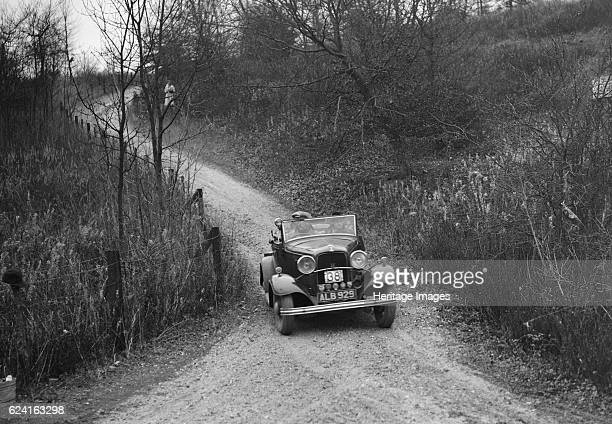 Ford V8 competing in the Great West Motor Club Thatcher Trophy 1938 Artist Bill BrunellFord V8 1933 3622 cc Vehicle Reg No ALB929 Event Entry No 38...