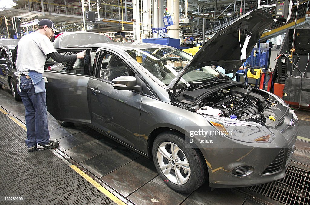 A Ford worker assembles a 2013 Ford Focus gasoline-powered, vehicle at the Michigan Assembly Plant November 8, 2012 in Wayne, Michigan. The plant is the only one in the world that builds vehicles with five different fuel efficient powertrains on the same line. Ford held an event today at the plant that celebrated the launch of the C-MAX Energi plug-in hybrid.