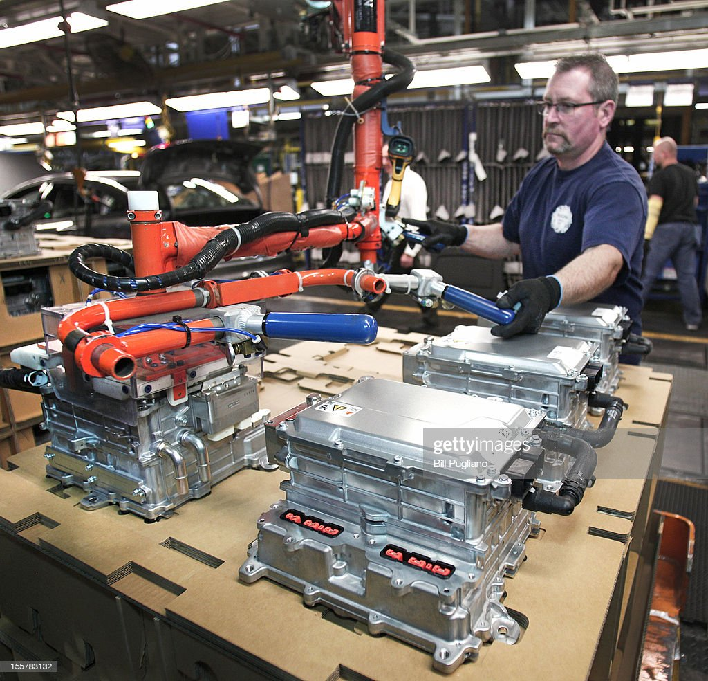 A Ford worker loads a component for an electric, hybrid and plug-in hybrid vehicles at the Michigan Assembly Plant November 8, 2012 in Wayne, Michigan. The plant is the only one in the world that builds vehicles with five different fuel efficient powertrains on the same line. Ford held an event today at the plant that celebrated the launch of the C-MAX Energi plug-in hybrid.