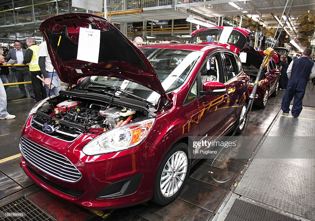 Ford workers assemble a C-MAX hybrid vehicle at the Michigan Assembly Plant November 8, 2012 in Wayne, Michigan. The plant is the only one in the world that builds vehicles with five different fuel efficient powertrains on the same line. Ford held an event today at the plant that celebrated the launch of the C-MAX Energi plug-in hybrid.