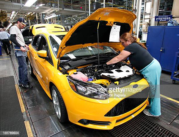 Ford workers assemble a Ford ST gasolinepowered vehicle at the Michigan Assembly Plant November 8 2012 in Wayne Michigan The plant is the only one in...