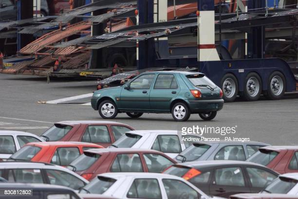 Ford workers loading cars onto car transporters at Dagenham Essex The last car came off the production line at the plant today which has produced...