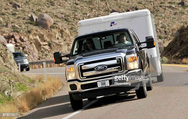 Ford's 2011 F250 Super Duty Power Stroke Diesel pickup truck is photographed pulling a 17000pound utility trailer up a mountain grade during a media...