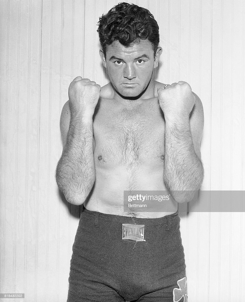 Fore-armed is fore-armed as far as Jim Braddock is concerned. Photographed at his Kenosha, Wisc., training camp, the champ is beginning to taper off training in preparation for his imminent bout with Joe Louis in Chicago.