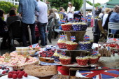 Foreground display of patriotic and royally themed homemade cakes to be consumed by the residents of Melbourne Road Wimbledon South West London...
