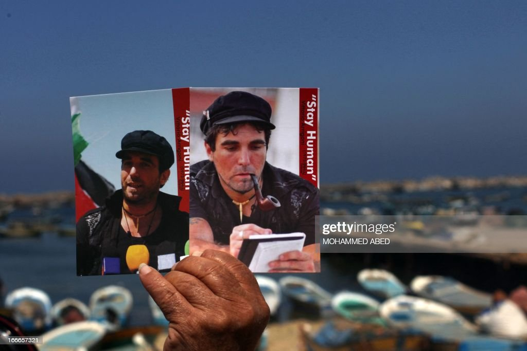 Foreign activists and Palestinians mark the second anniversary of the murder of Italian peace activist Vittorio Arrigoni on April 15, 2013 in Gaza City. Arrigoni, a 36-year-old member of the International Solidarity Movement (ISM), was found hanged in April 2011 in an abandoned house north of Gaza City after a radical salafist group had posted a video of him online and threatened to kill him unless Hamas released an unspecified number of their members, sending shock waves across Gaza and the community of international aid workers in the coastal territory where he had lived and worked for around three years. AFP PHOTO/MOHAMMED ABED