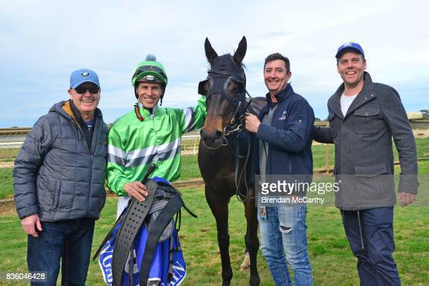 Foreign Affair with Chris Symons and owners jarred and Wayne Byers after winning the Border Inn Murray Mallee Winter Sprint Final at Echuca...