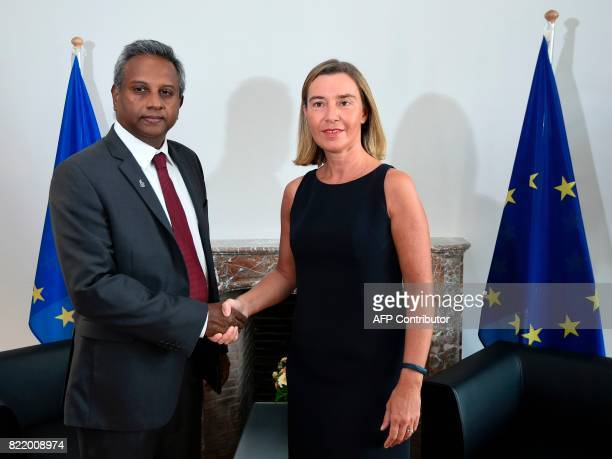 EU foreign affairs chief Federica Mogherini welcomes Secretary General of Amnesty International Salis Shetty prior to their bilateral meeting at the...