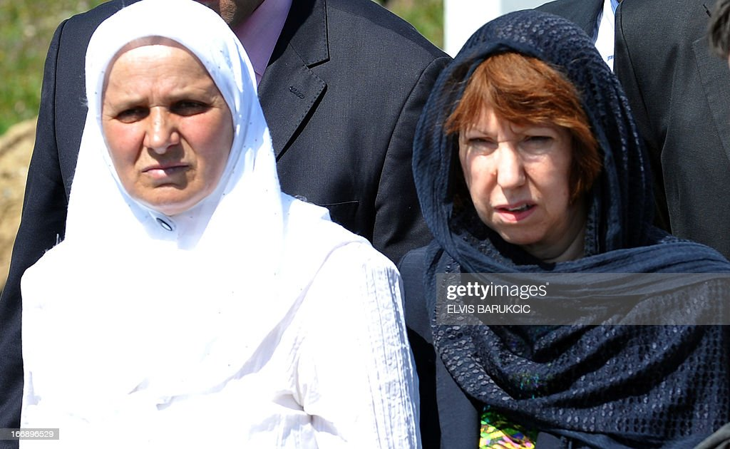 EU Foreign Affairs head Catherine Ashton (R), accompanied by Hatidza Mehmedovic (L) of 'Mothers of Srebrenica Association', pays respect to Srebrenica victims at the Memorial Cemetery in Potocari, near Srebrenica, on April 18, 2013. Catherine Ashton arrived in Bosnia early on April 18 and held several meetings with Bosnian top officials and international representatives to the country. In the afternoon Ashton visited Potocari and met with women who survived the 1995 massacre in Srebrenica and lost about 8000 of their most beloved ones. In July 1995, Bosnian Serb forces killed and dumped in mass graves some 8,000 Muslim men and boys, in the worst massacre in Europe since World War II.