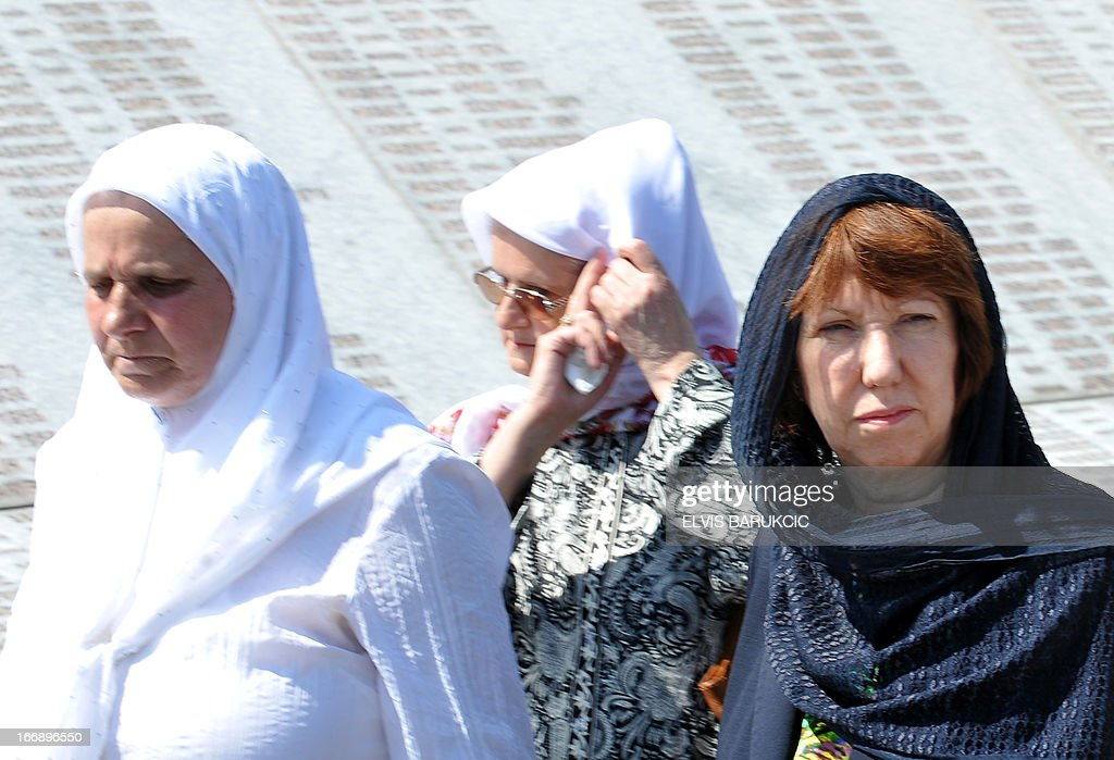 EU Foreign Affairs head Catherine Ashton (R), surrounded by Hatidza Mehmedovic (L) of 'Mothers of Srebrenica Association', pays respect to Srebrenica victims at the Memorial Cemetery in Potocari, near Srebrenica, on April 18, 2013. Catherine Ashton arrived in Bosnia early on April 18 and held several meetings with Bosnian top officials and international representatives to the country. In the afternoon Ashton visited Potocari and met with women who survived the 1995 massacre in Srebrenica and lost about 8000 of their most beloved ones. In July 1995, Bosnian Serb forces killed and dumped in mass graves some 8,000 Muslim men and boys, in the worst massacre in Europe since World War II.