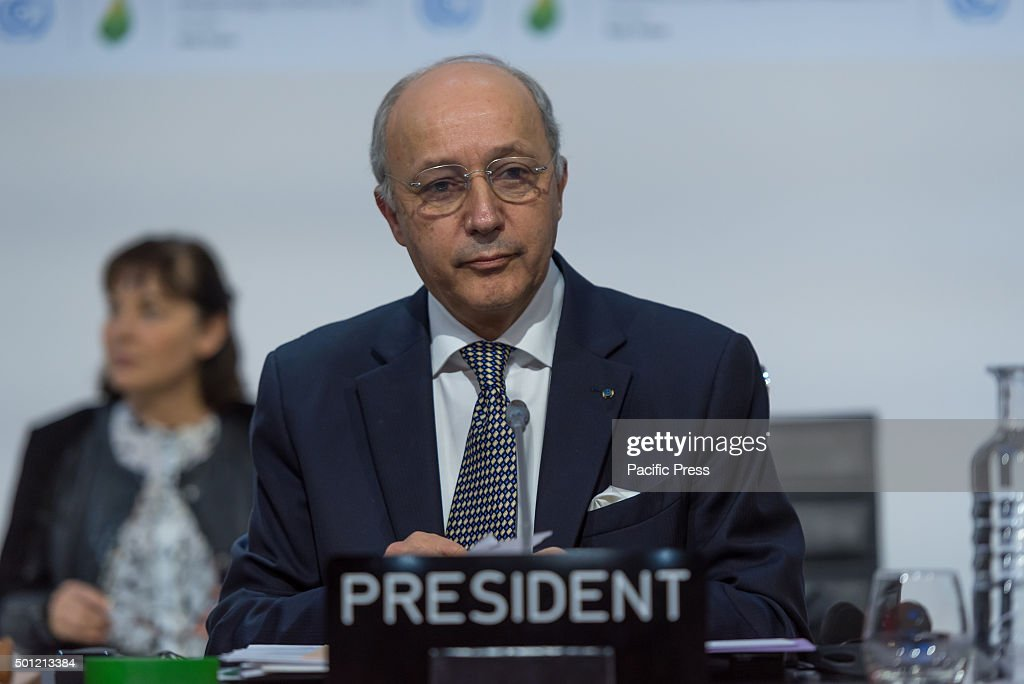 Foreign Affairs Minister and President-designate of COP21 <a gi-track='captionPersonalityLinkClicked' href=/galleries/search?phrase=Laurent+Fabius&family=editorial&specificpeople=540660 ng-click='$event.stopPropagation()'>Laurent Fabius</a> receives notes from South Africa, during the final agreement and went to talk with advisors before making the final address during the closing of the COP21 Climate Conference in Paris.