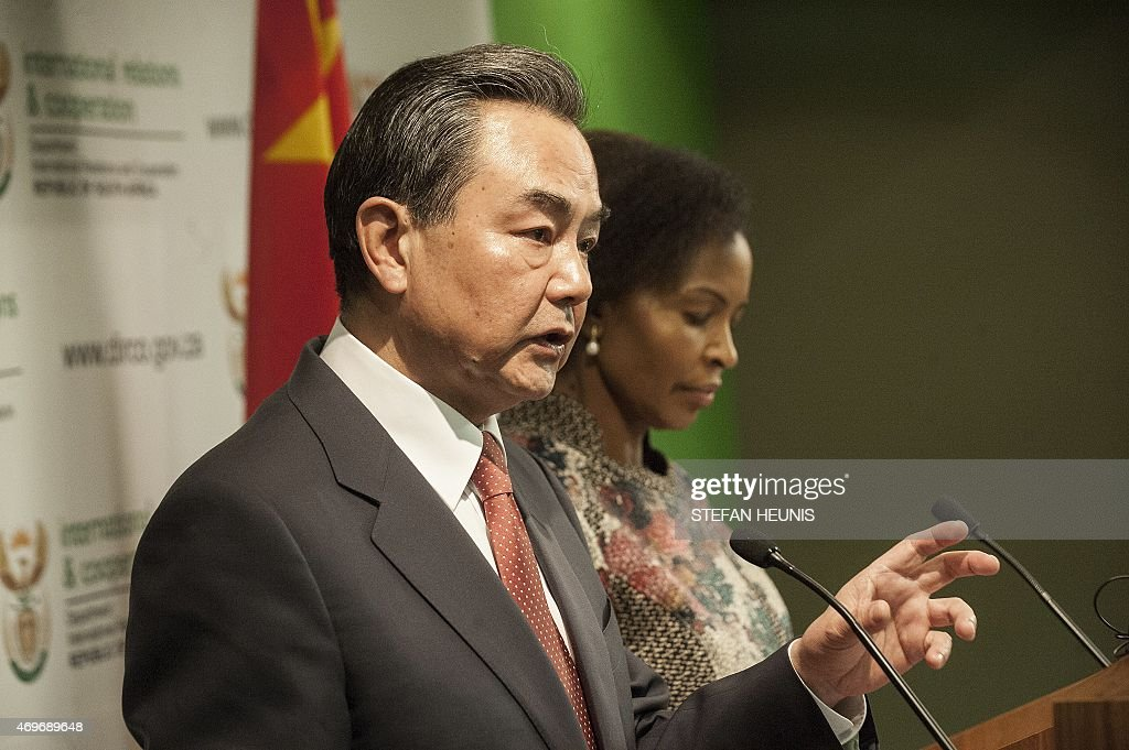 Foreign Affairs Minister of the People's Republic of China Mr. <a gi-track='captionPersonalityLinkClicked' href=/galleries/search?phrase=Wang+Yi+-+Politico&family=editorial&specificpeople=13620429 ng-click='$event.stopPropagation()'>Wang Yi</a> speaks during a press conference with South African counterpart Ms. Maite Nkoana Mashabane (R) in Pretoria on April 14, 2015. AFP PHOTO/STEFAN HEUNIS