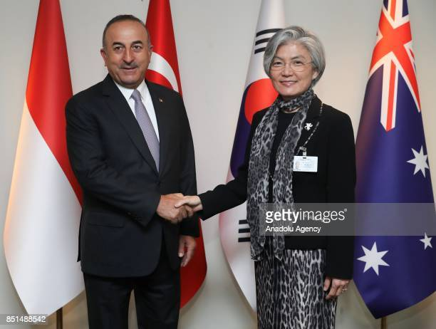 Foreign Affairs Minister of Turkey Mevlut Cavusoglu shakes hands with Foreign Affairs Minister of South Korea Kang KyungWha during the MIKTA meeting...