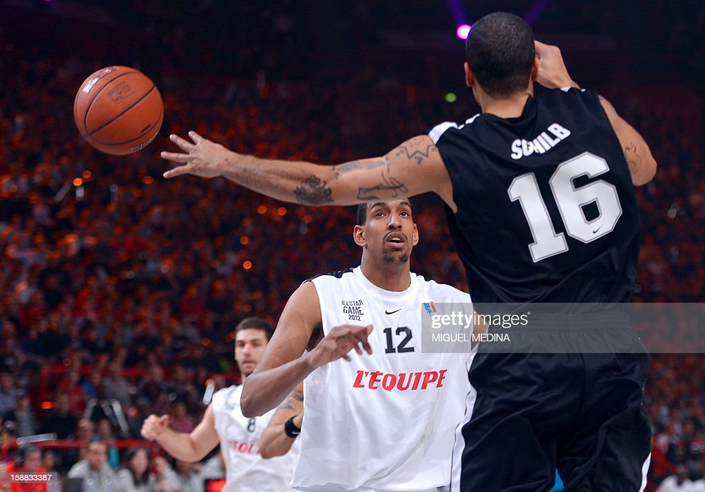 Foreign All Star player Blake Schilb (R) vies with French All Star player Alexis Ajinca (L) during France's national basketball league (LNB) 2010 All Star Game match on December 30, 2012 at the Palais Omnisport de Paris-Bercy (POPB) in Paris.