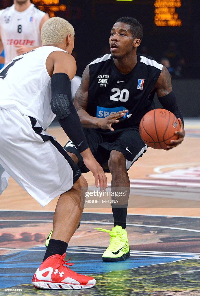 Foreign All Star player Dwight Buycks (R) vies with French All Star player Edwin Jackson (L) during France's national basketball league (LNB) 2010 All Star Game match on December 30, 2012 at the Palais Omnisport de Paris-Bercy (POPB) in Paris. AFP PHOTO MIGUEL MEDINA