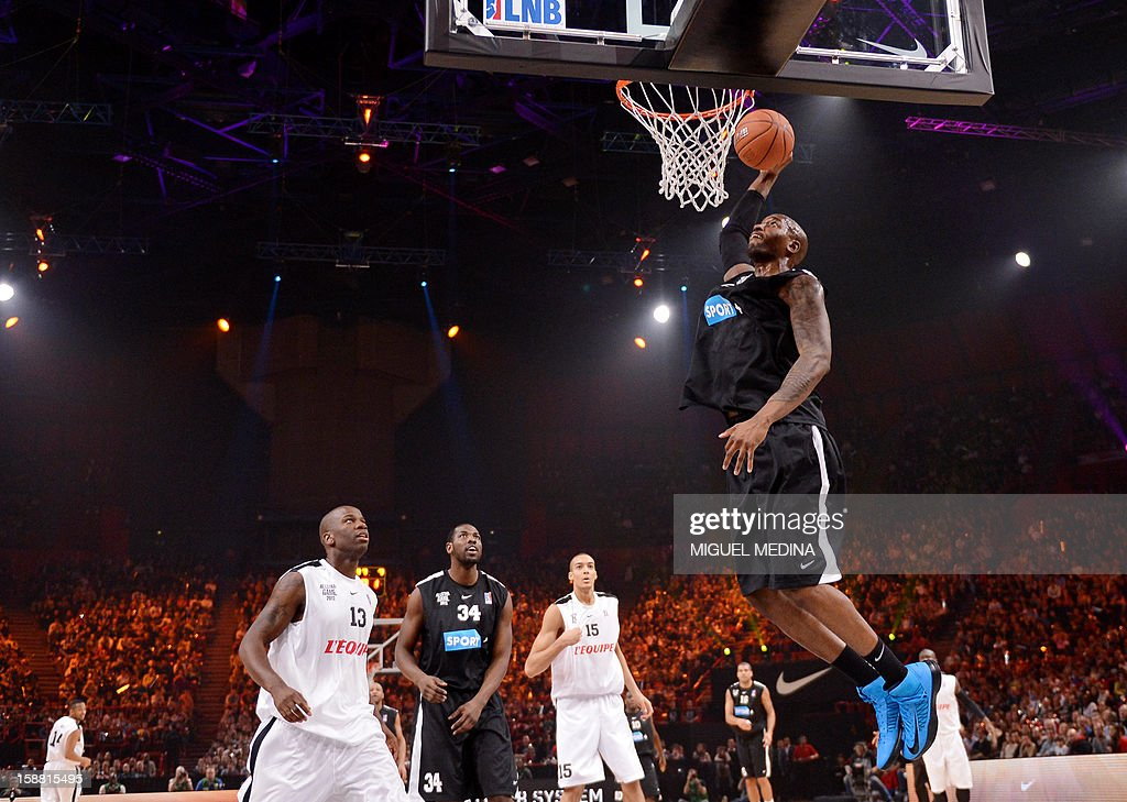 Foreign All Star player, US Jawad Williams (L), jumps to score against French All star players Steed Tcicamboud (L) and Rudy Gobert (C, background) as teammate US Ahmad Nivins looks on during the France's national basketball league (LNB) 2012 All Star Game on December 30, 2012 at the Palais Omnisport de Paris-Bercy (POPB) in Paris.