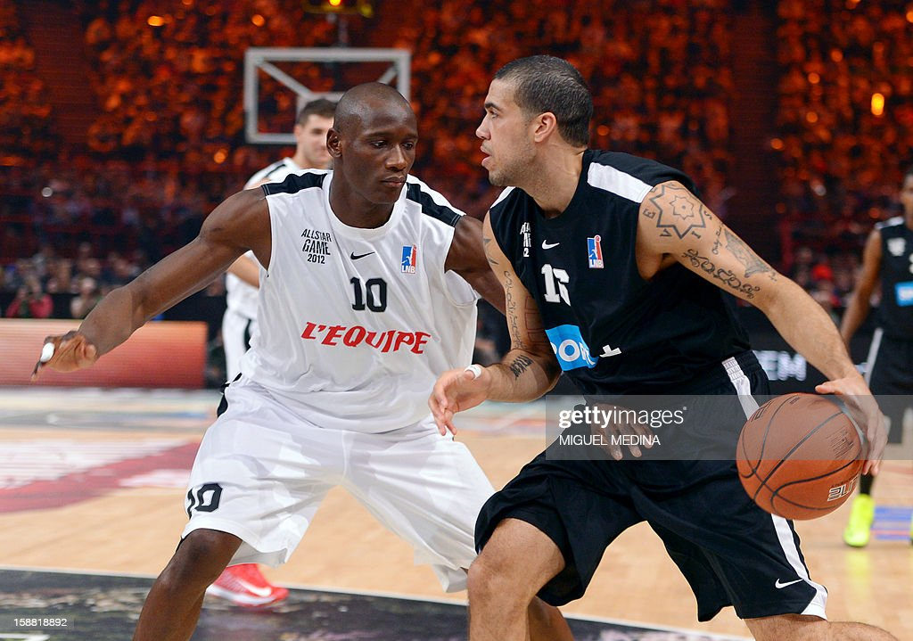 Foreign All Star US player Blake Schilb (R) vies with French All star player Amara Sy during the France's national basketball league (LNB) 2012 All Star Game on December 30, 2012 at the Palais Omnisport de Paris-Bercy (POPB) in Paris.