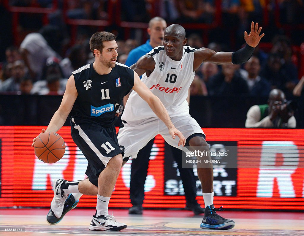 Foreign All Star US player Kyle McAlarney (L) vies with French All star player Amara Sy (R) during the France's national basketball league (LNB) 2012 All Star Game on December 30, 2012 at the Palais Omnisport de Paris-Bercy (POPB) in Paris.