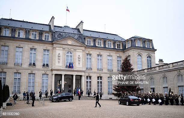 Foreign ambassadors arrive to attend the New Year wishes ceremony of French President to the diplomatic corps on January 12 2017 at the Elysee...