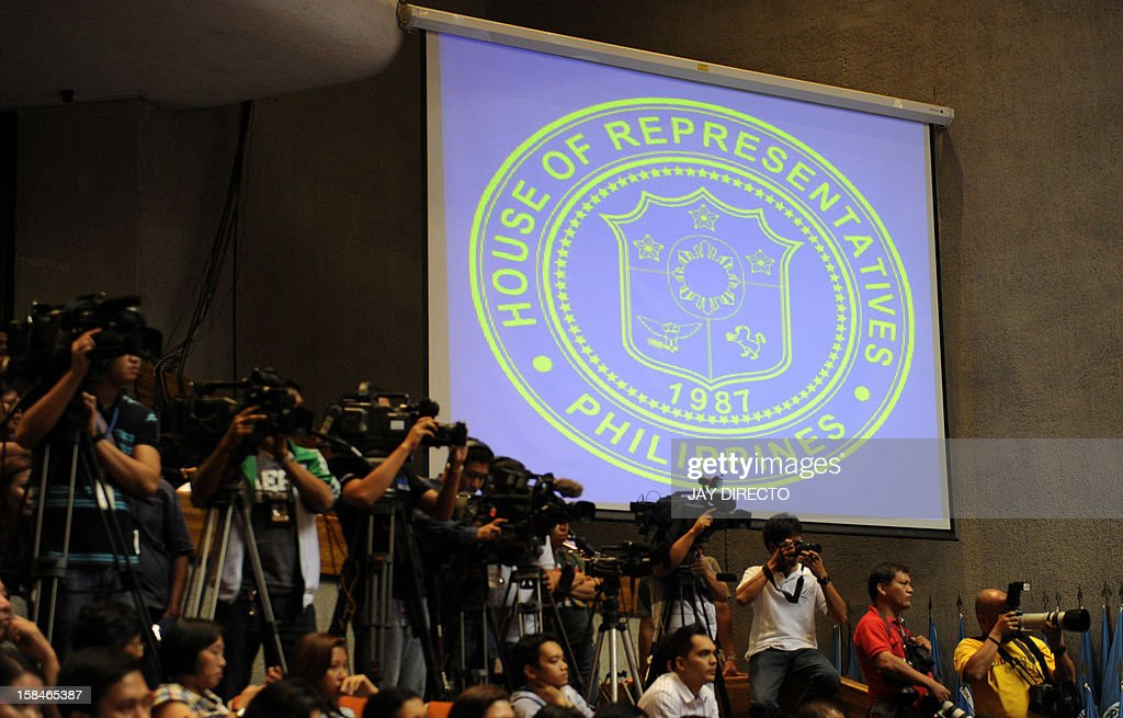 Foreign and local media work as legislators vote for the Reproductive Health Bill (RH) at the plenary hall of the House of Representatives in Quezon City suburban Manila on December 17, 2012. Philippine legislators on Monday passed a landmark birth control bill paving the way for increased sex education and free contraceptives, despite intense lobbying by the Catholic church.