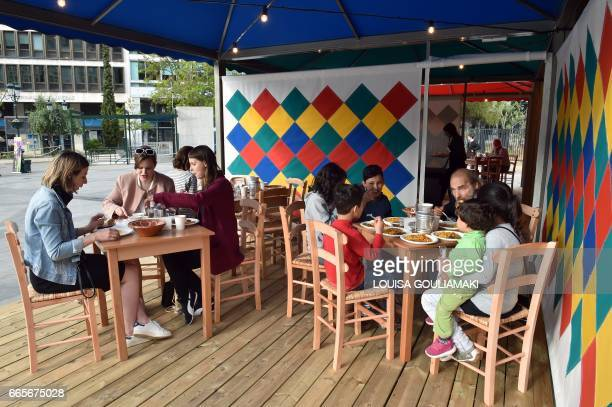 Foreign artists refugee children and residents share tables for lunch as they take part in a performance by Pakistani artist Rasheed Araeen entitled...